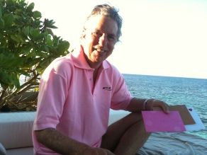 Steve in the Maldives with 40th anniversary cards